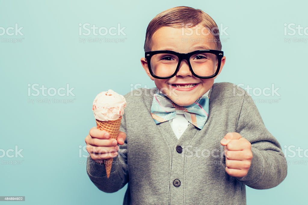 Young Nerd Boy with Ice Cream Cone stock photo