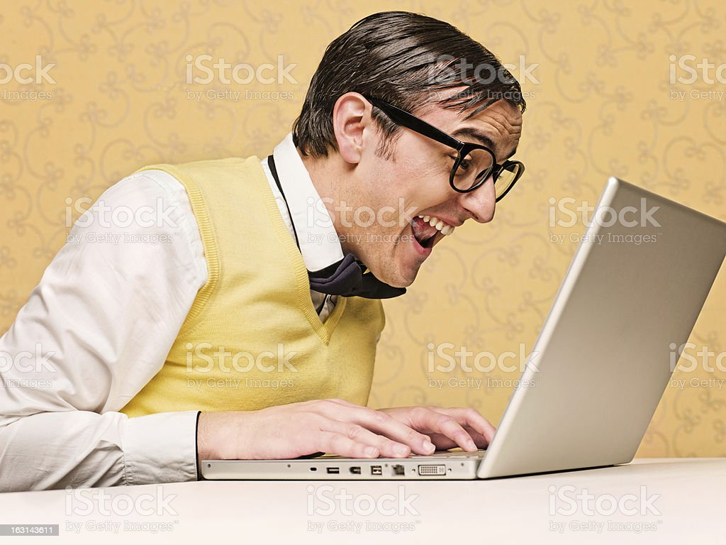 Young nerd sitting at the computer royalty-free stock photo