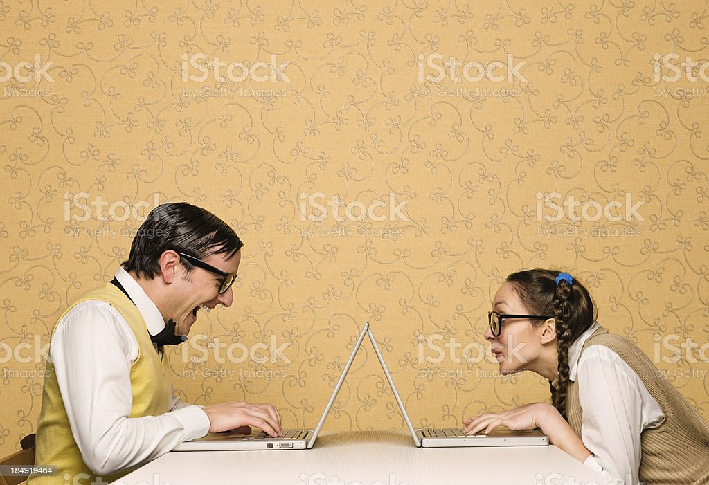 Young nerds chatting stock photo