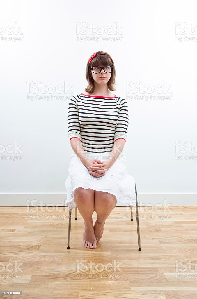 Young nerdy lady siting royalty-free stock photo