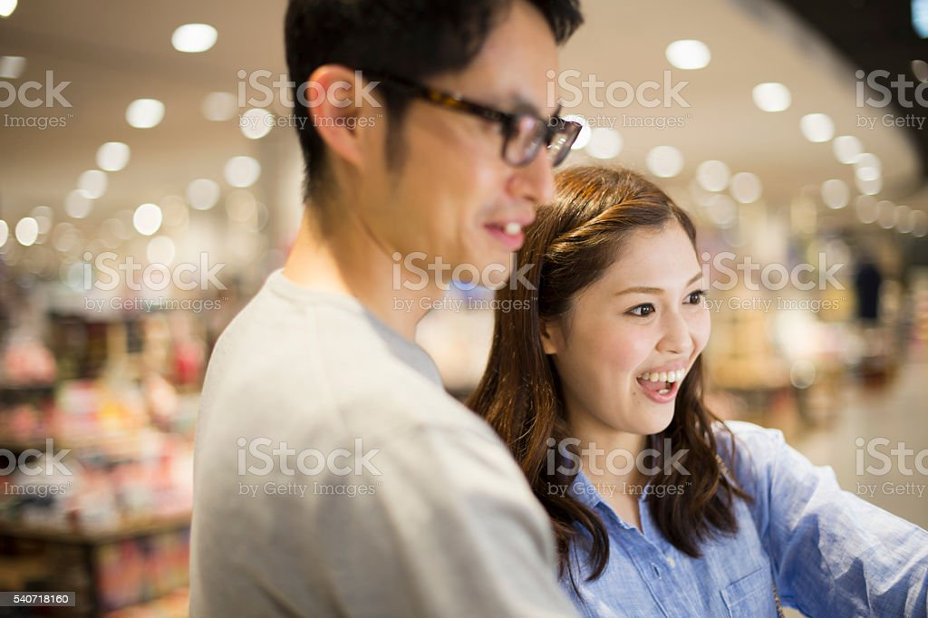 Young newlyweds  looking at home appliances in a department stock photo