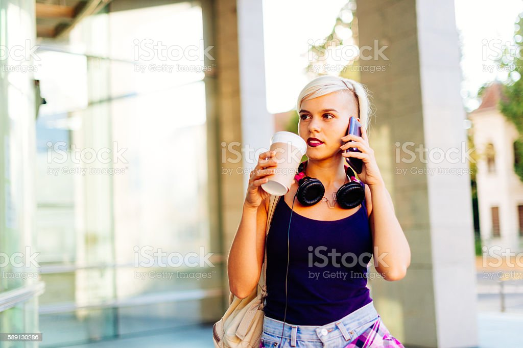Young Northern European woman in city downtown stock photo
