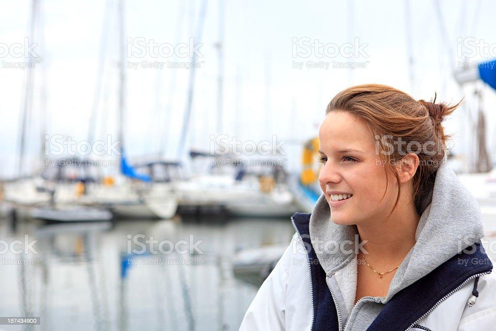 Young Norwegian woman at the marina royalty-free stock photo