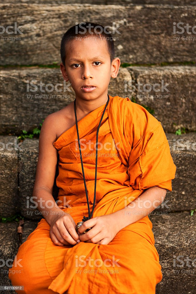Young Novice Buddhist monk near Kandy, Sri Lanka stock photo