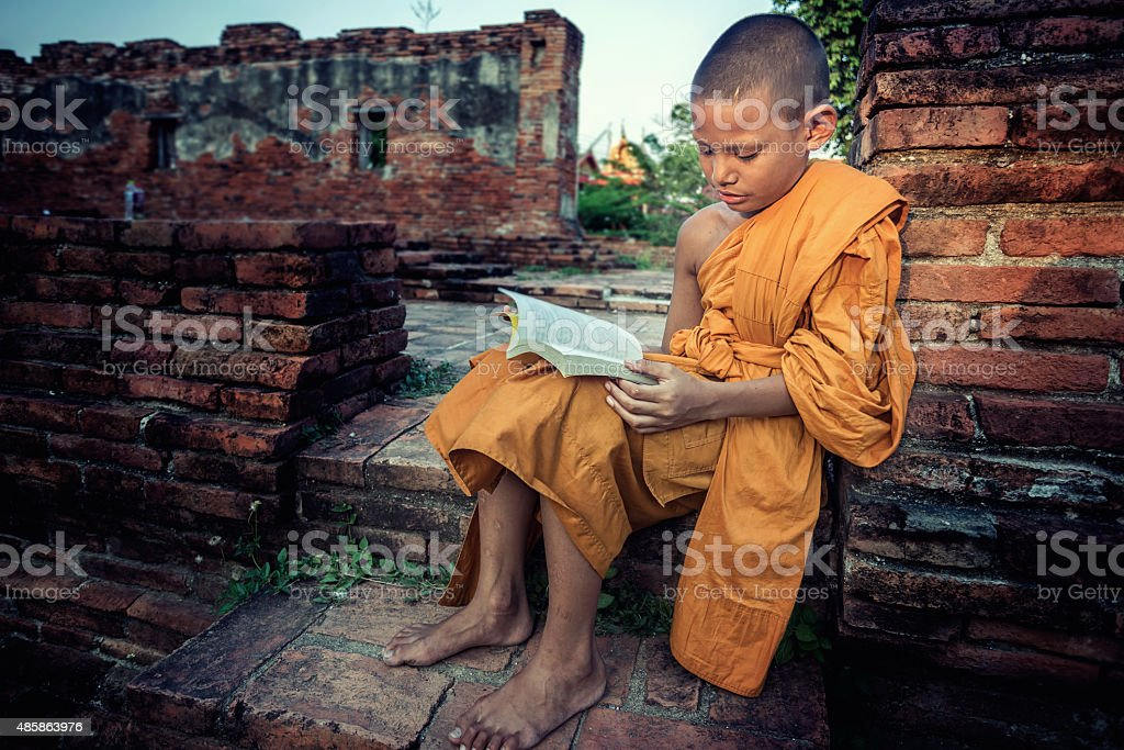 Young Novice reading book stock photo