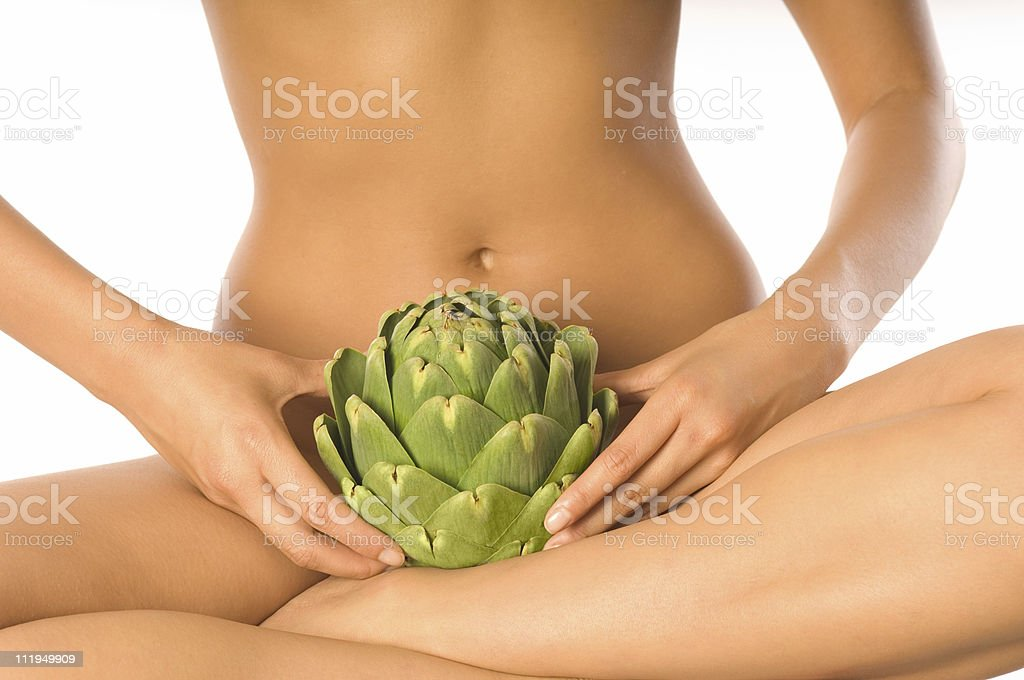 Young Nude Woman Holding Artichoke in Lap royalty-free stock photo