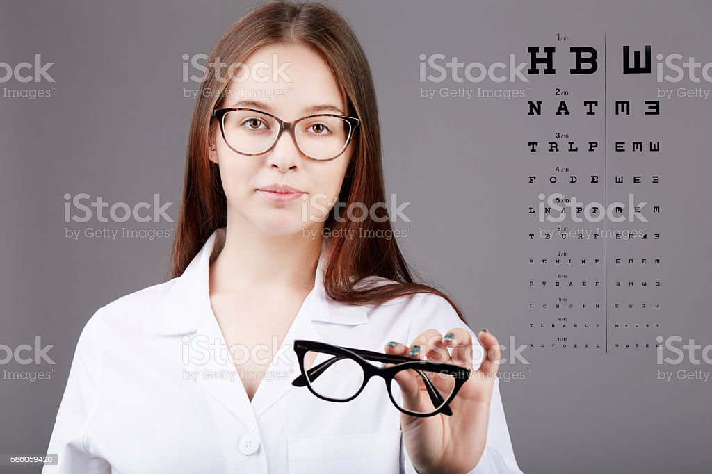 young oculist showing new eyeglasses stock photo