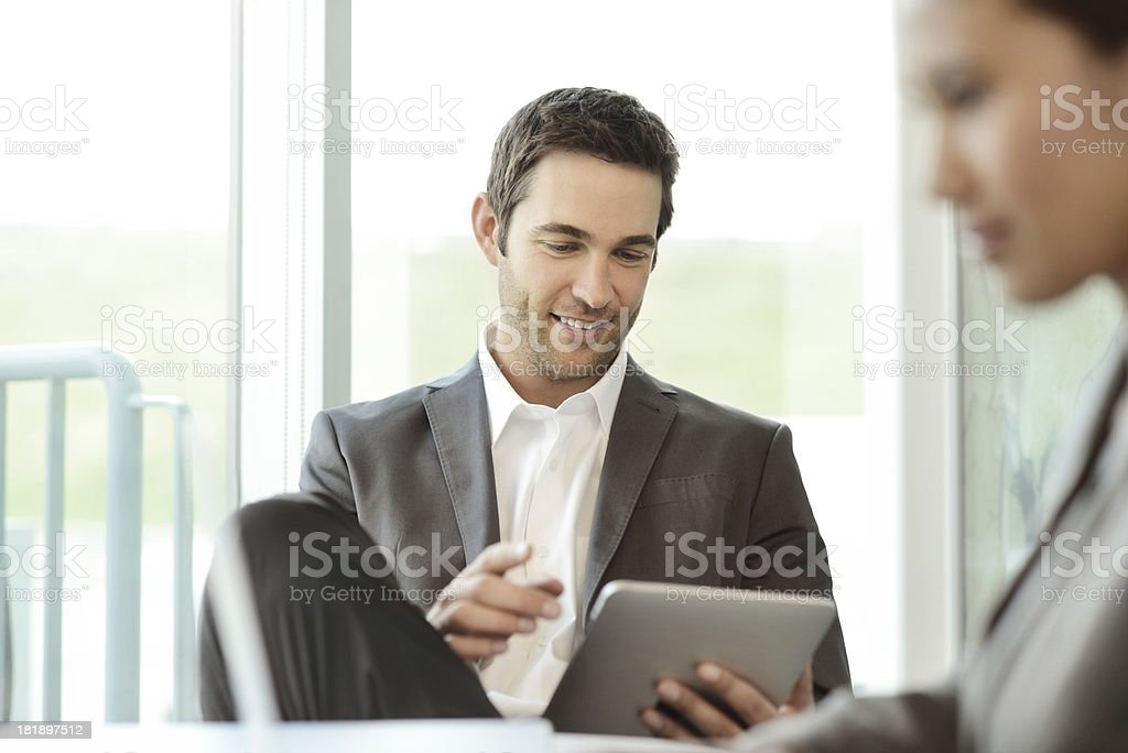 Young Office Employees Using Mobile Computing Devices royalty-free stock photo