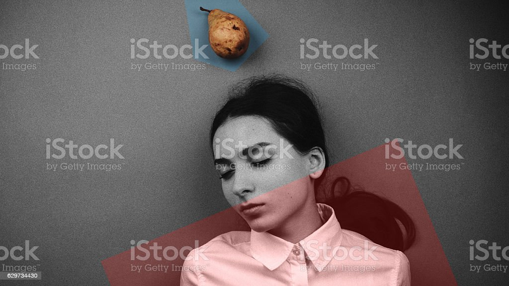 Young office female dreams about lunch with a pear fruit stock photo