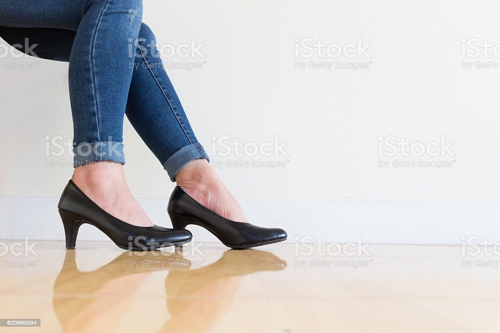 Young office Woman blue jeans Wearing High-heeled stock photo