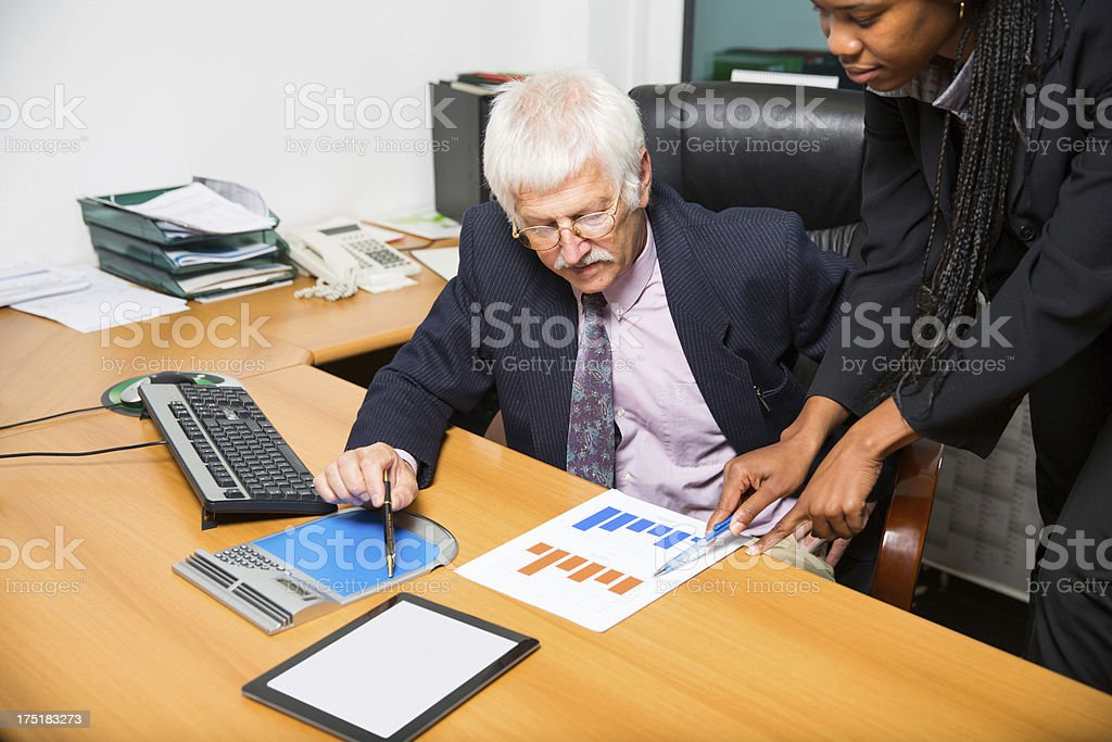 Young office worker and senior manager royalty-free stock photo