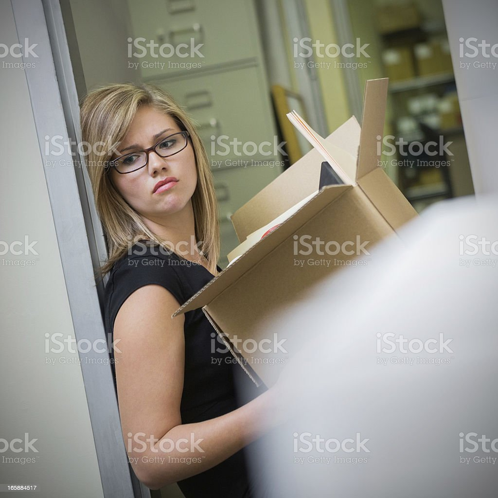 Young office worker is upset after being fired from job royalty-free stock photo