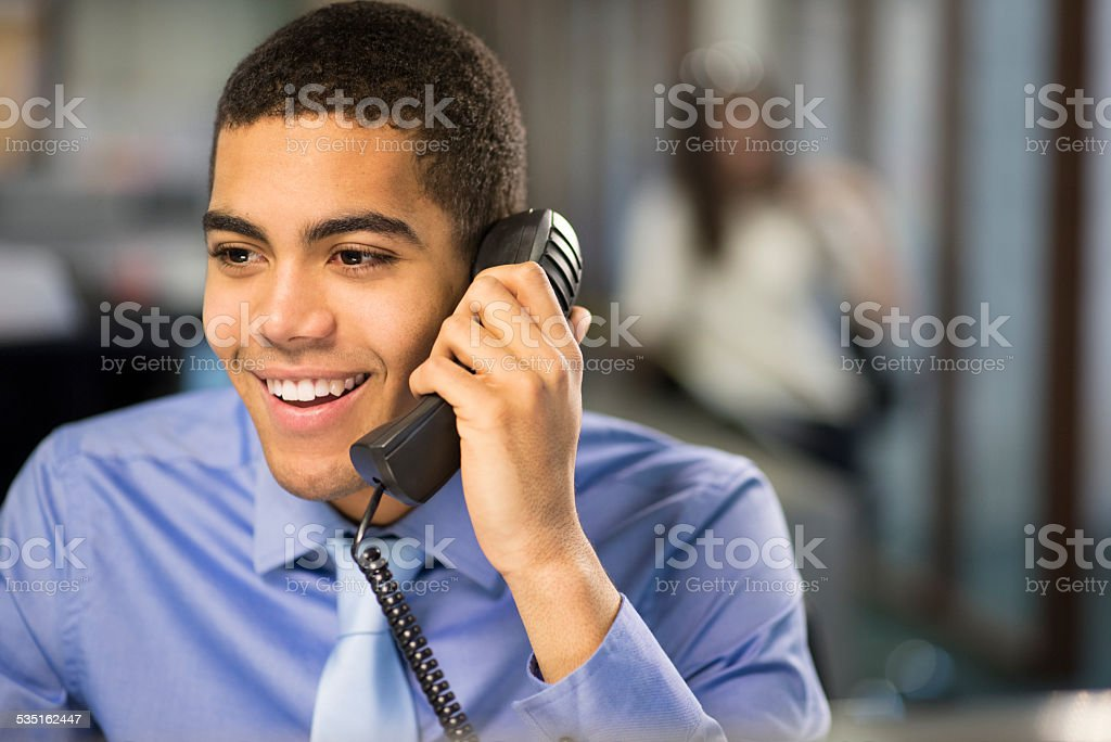 young office worker on the phone stock photo