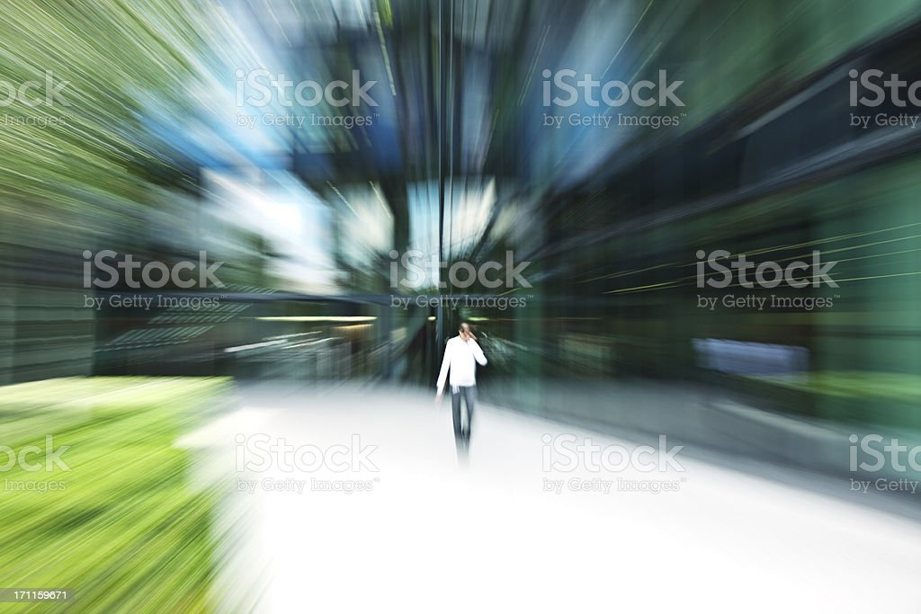 Young Office Worker Walking in Front of an Business Building royalty-free stock photo