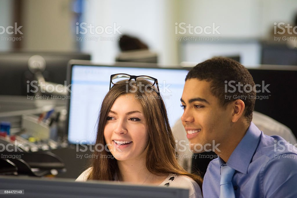 young office workers discussing stock photo