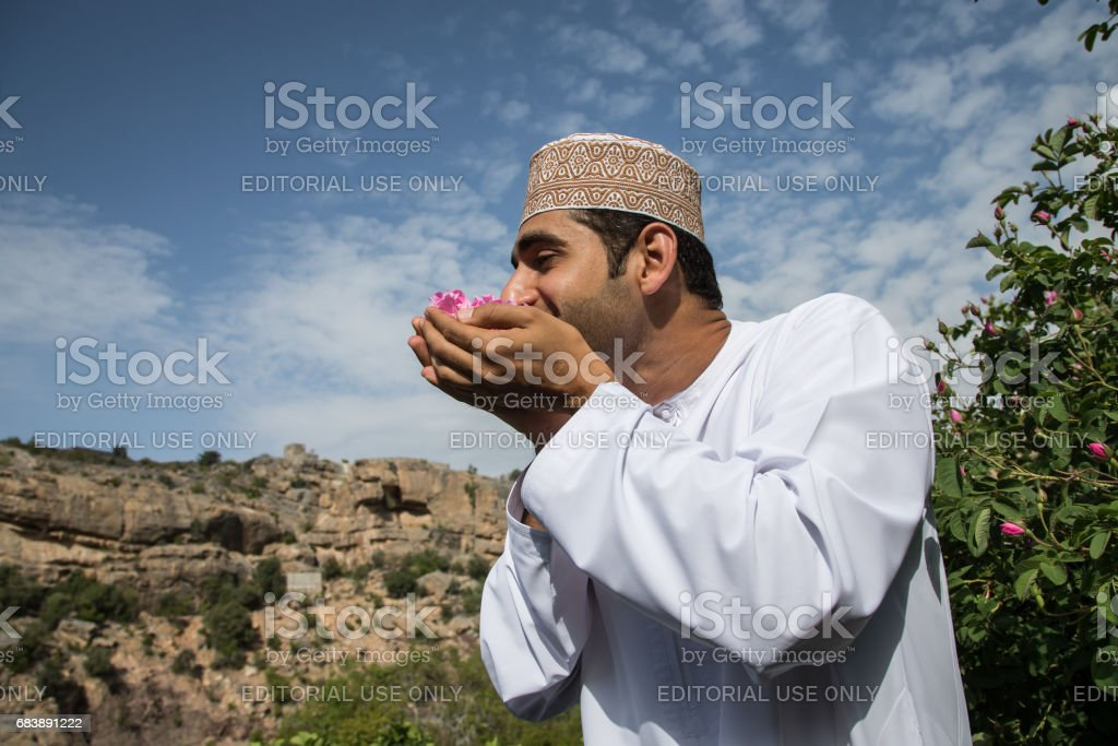 young oman man smelling rose petals stock photo