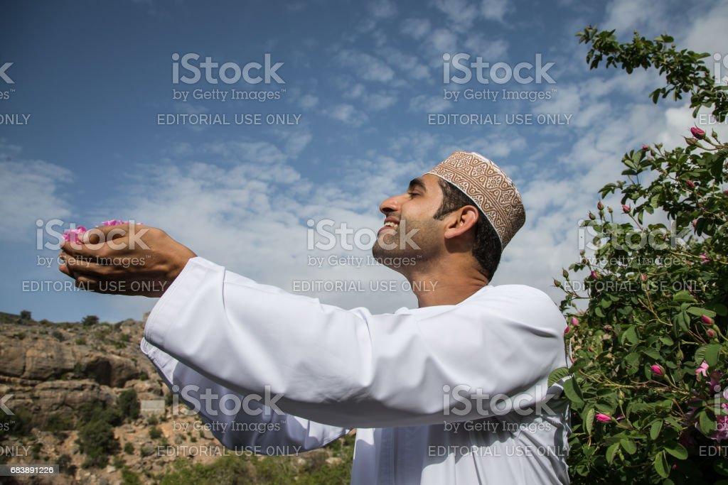 young oman man smelling rose petals stock photo