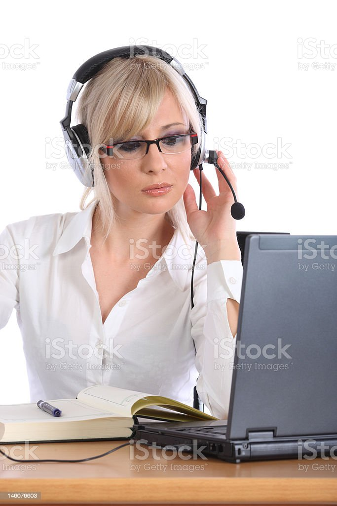 Young operator with the headphones working royalty-free stock photo