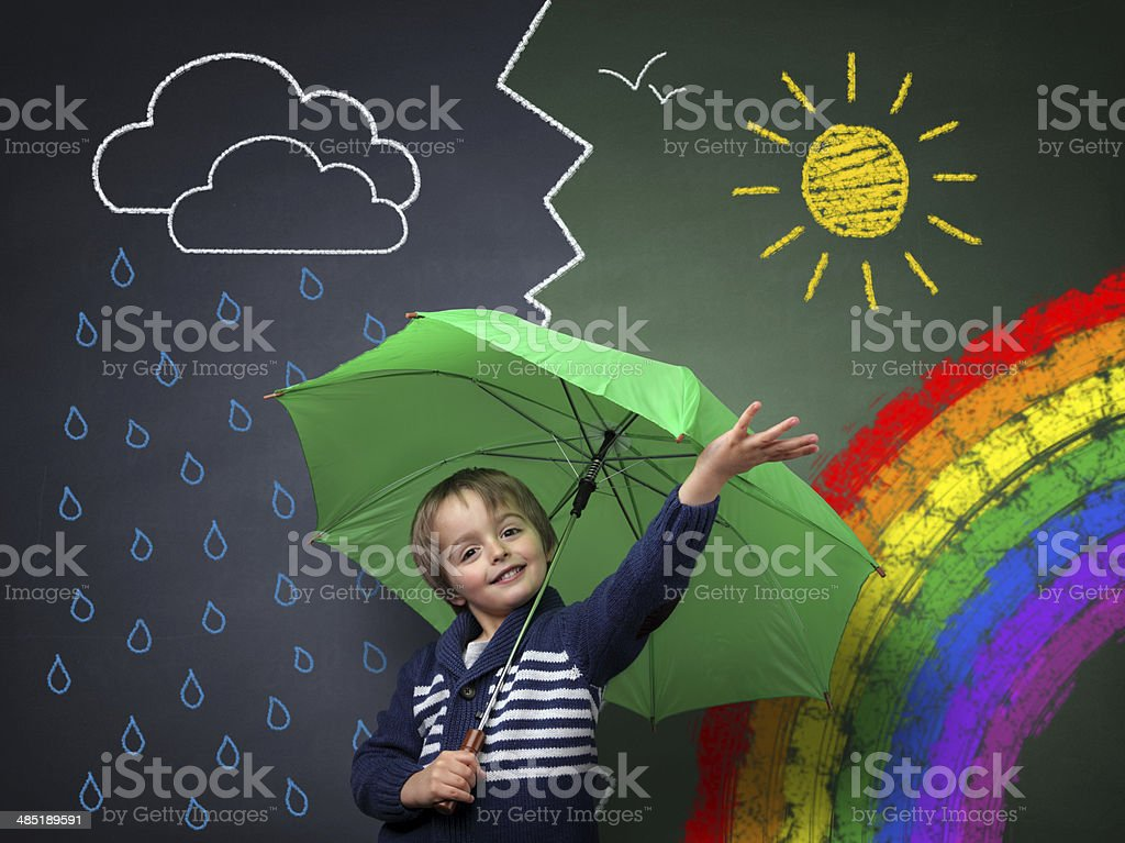 Young optimist - a change in the weather stock photo
