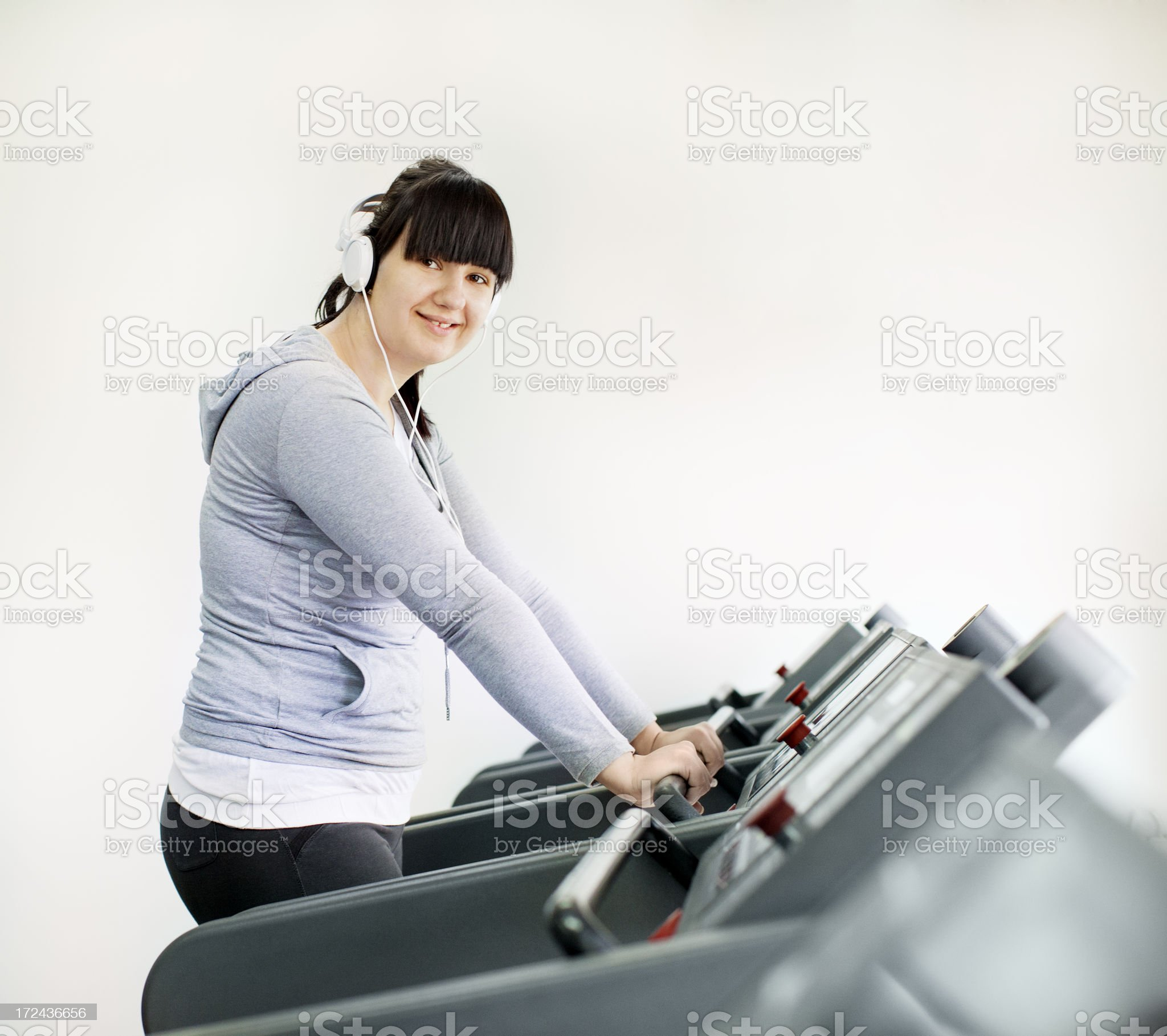 Young Overweight Woman Exercise in a gym royalty-free stock photo