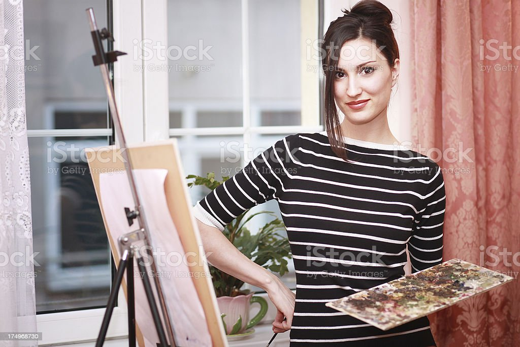 Young painter in her atelier royalty-free stock photo