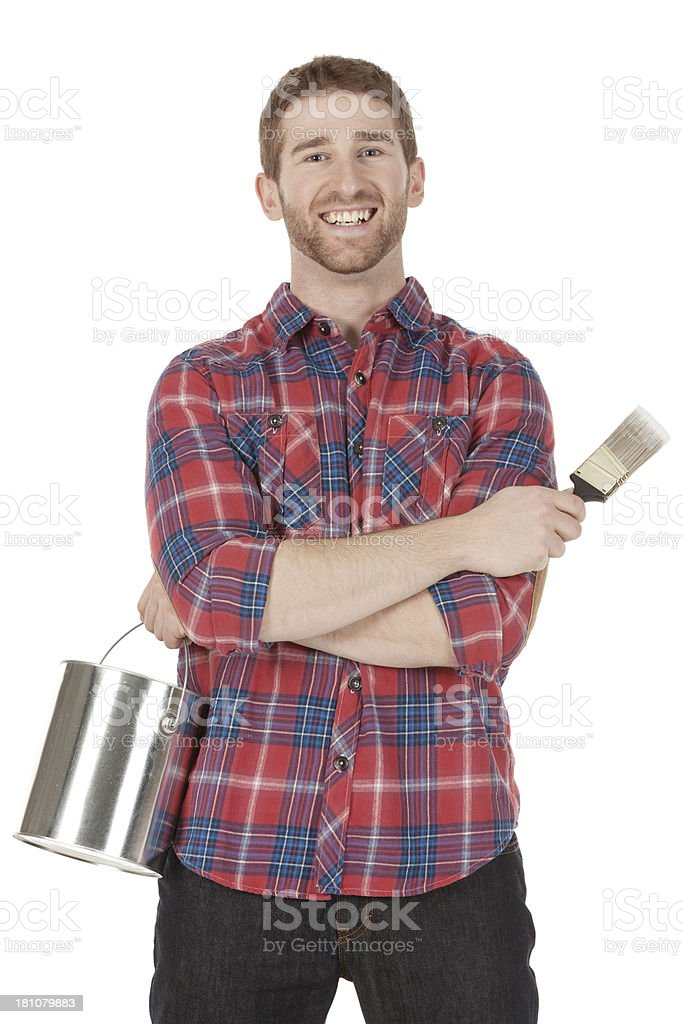 Young painter with a paint can and paintbrush royalty-free stock photo