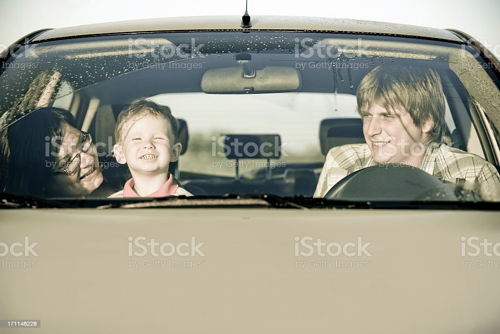 Young parents and son in the car royalty-free stock photo