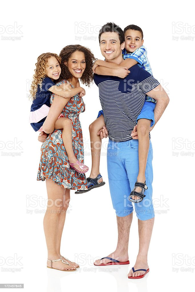 Young parents piggybacking their kids royalty-free stock photo