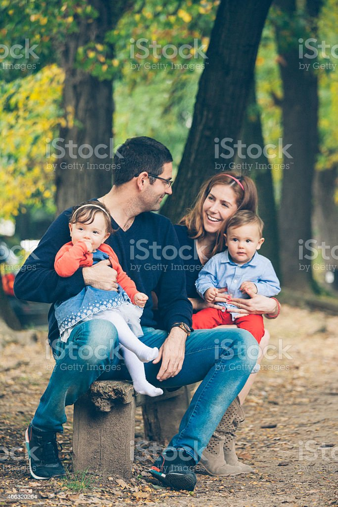 Young parents with children in the park stock photo