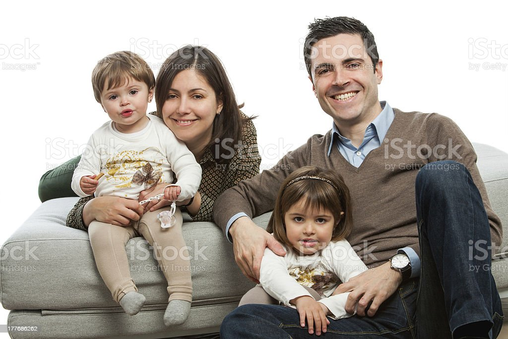 Young parents with kids on couch. royalty-free stock photo