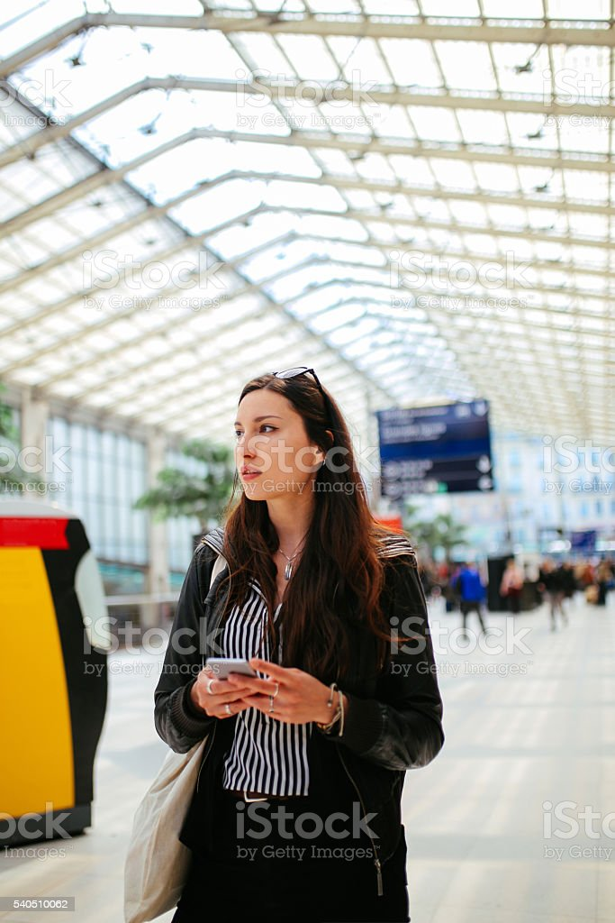 Young Parisian woman on the train station stock photo