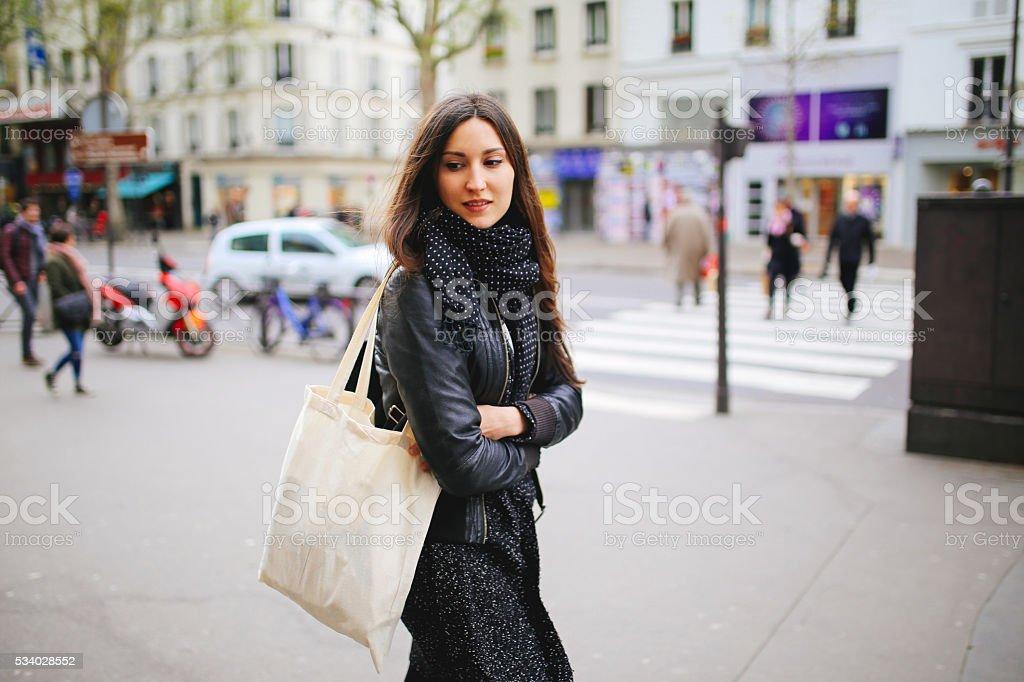 Young Parisian woman walking stock photo