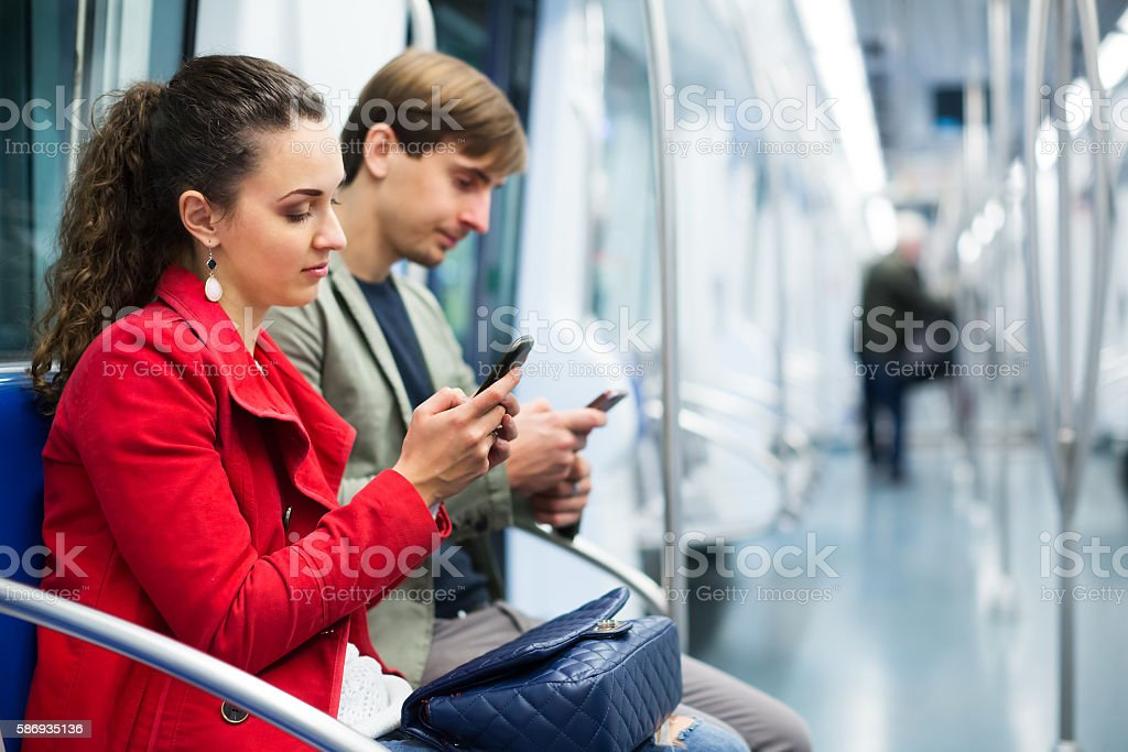 Young passengers in subway car stock photo