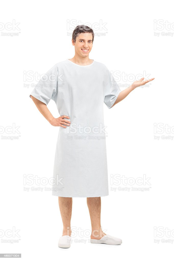 Young patient in a hospital gown gesturing with hand stock photo