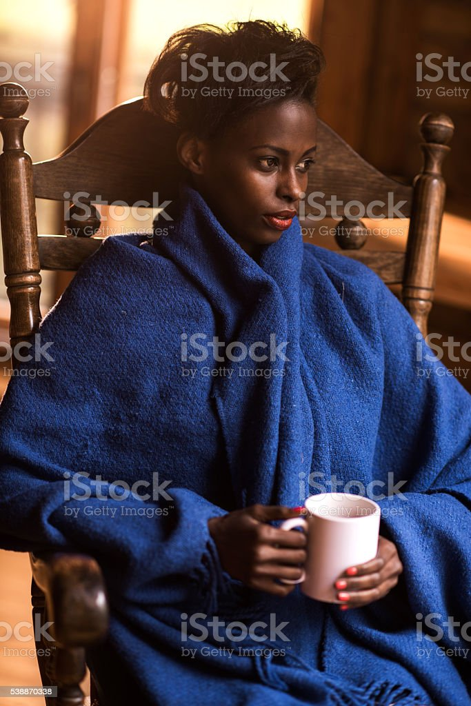 Young pensive African American woman during her coffee time. stock photo