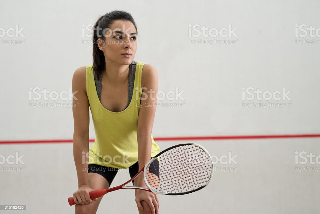 Young pensive athlete taking a break from racketball game. stock photo
