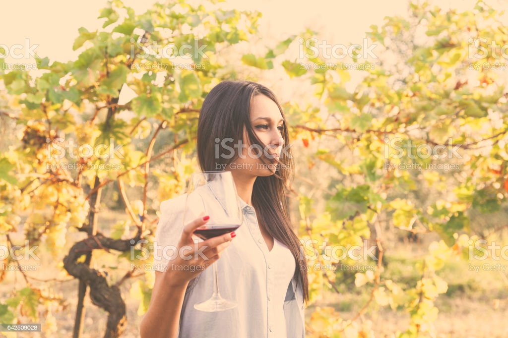 young pensive woman in a vineyard stock photo