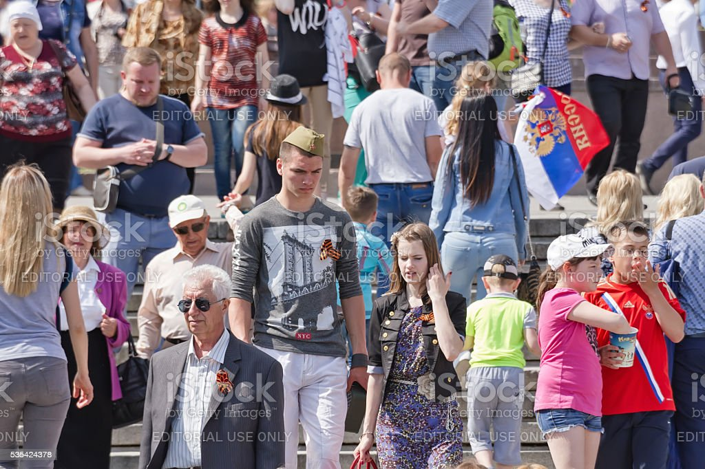 Young people and older people with St. George ribbons stock photo