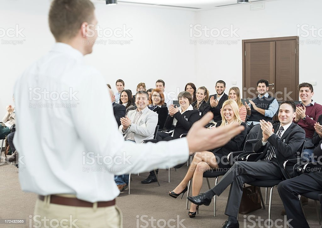 Young people applauding to a seminar presenter royalty-free stock photo