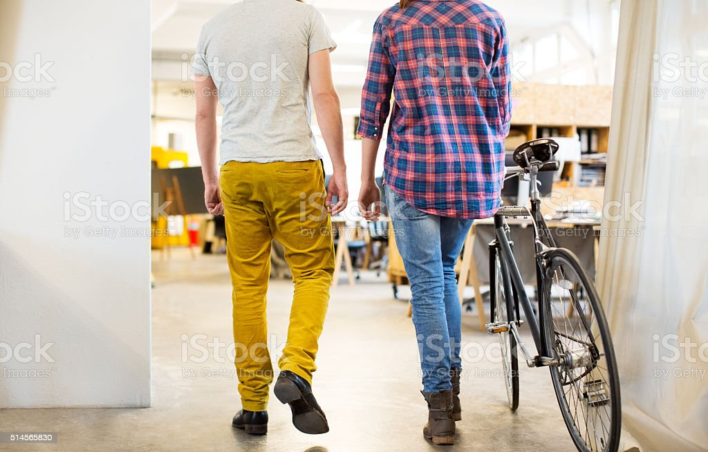 Young people arriving at work with a bicycle stock photo