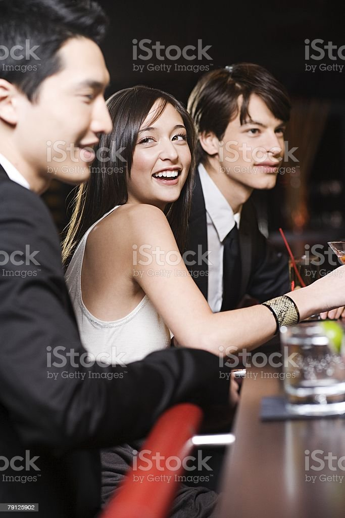 Young people at a bar stock photo