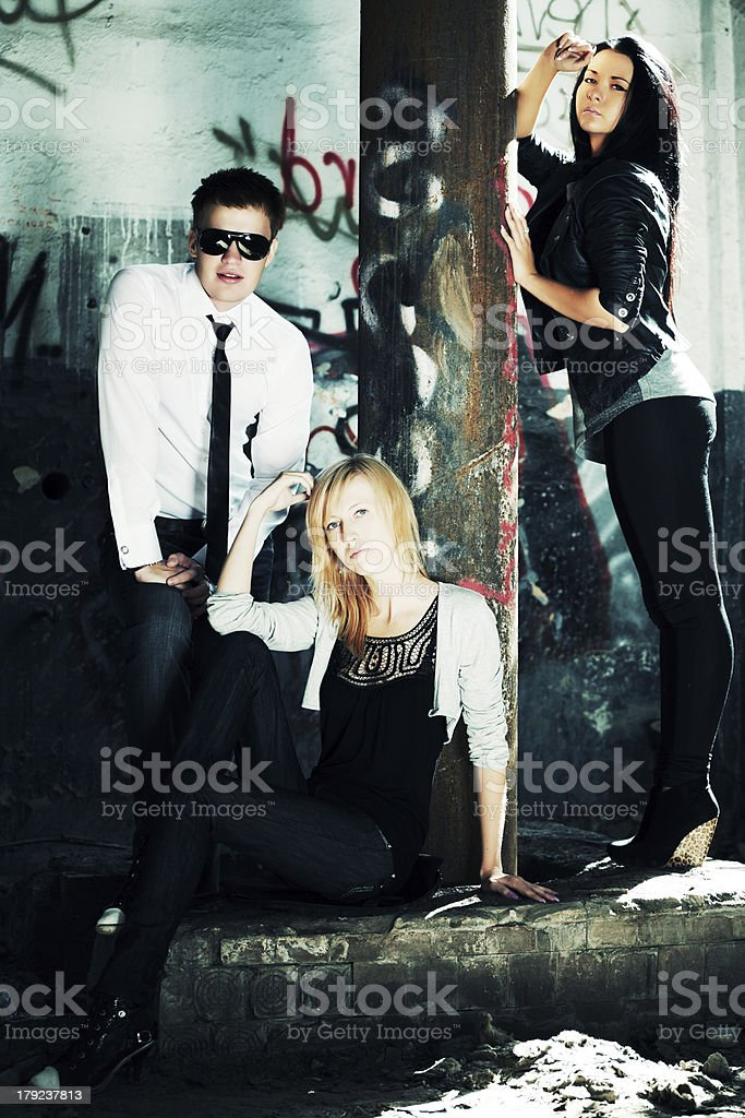 Young people at abandoned apartment royalty-free stock photo