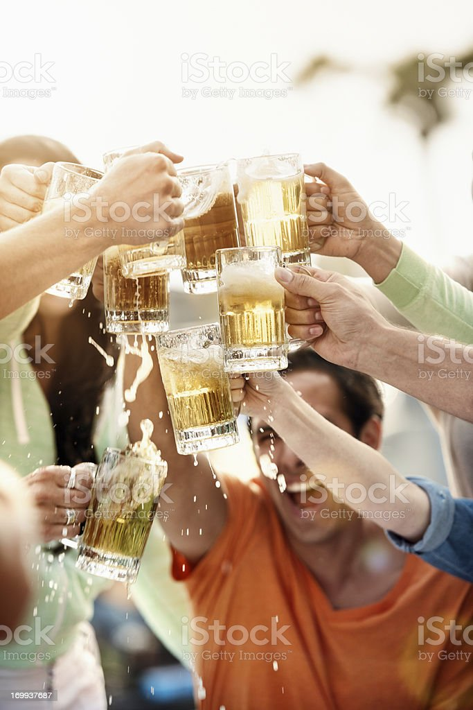 Young people at bistro having beer. royalty-free stock photo