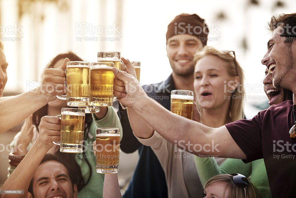 Young people at bistro having beer stock photo