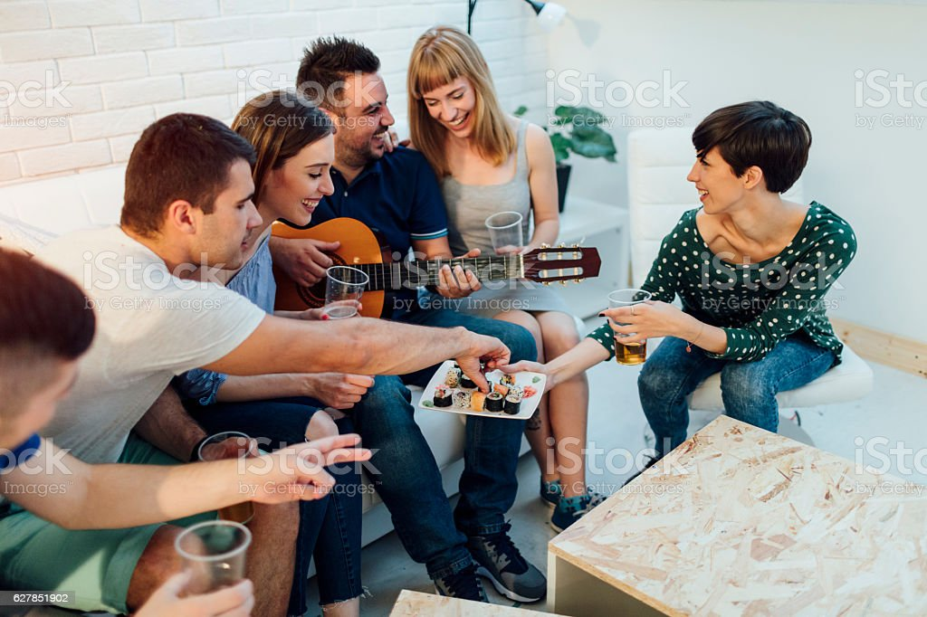 Young People At Home Party. stock photo