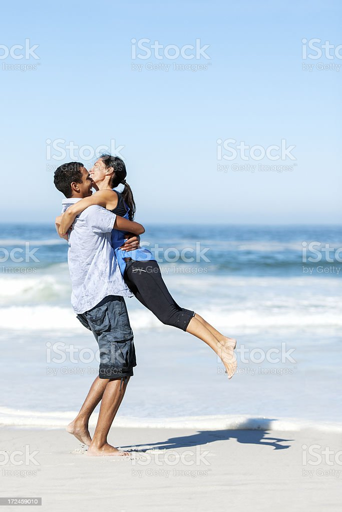 Young people at the beach royalty-free stock photo