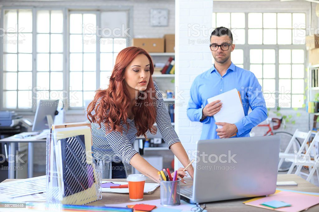 Young people at workplace stock photo