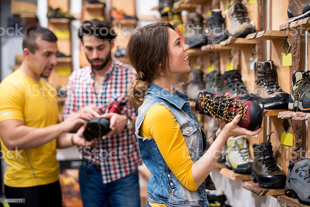 Young people buying hiking shoes stock photo
