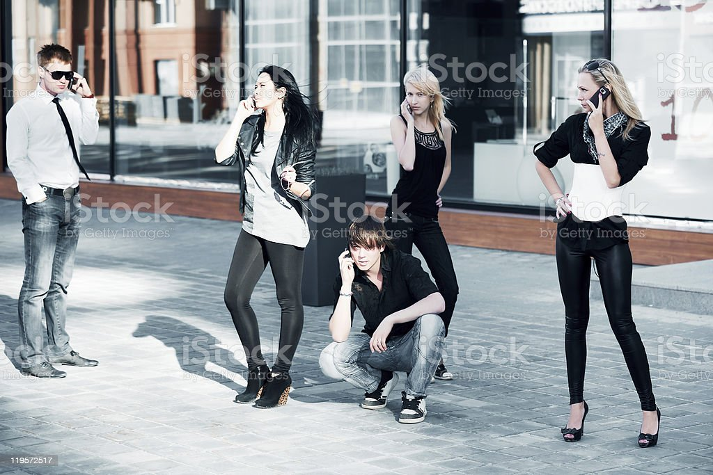 Young people calling on the phones royalty-free stock photo