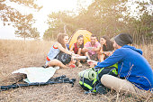 Young people camping in nature